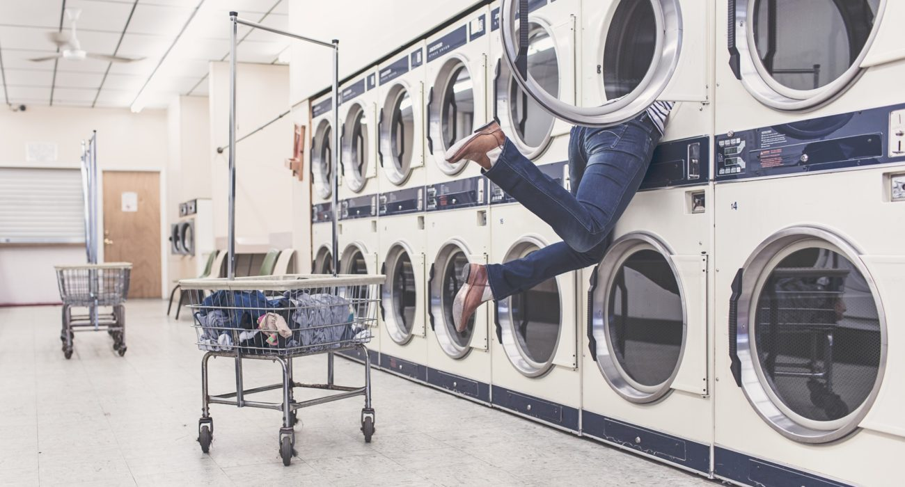 woman stuck inside of a laundry machine - marketing confusion